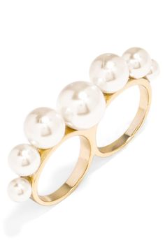 Modern twist on a pearl cocktail ring.