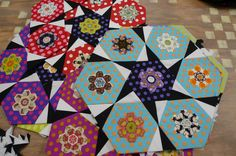 Hexagon stars with small hexies appliqued on larger dotty hexagons