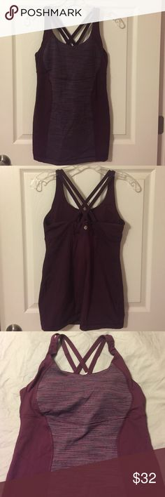 Lululemon tank Wine colored with multicolored panel that contains gray, muted pink, black colors. Criss-cross back and bra pads (included). Hits just below hips. Very flattering!  The last 2 pics represent the true color. lululemon athletica Tops Tank Tops