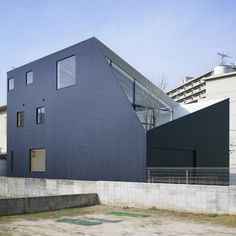 Japanese architects Future Studio completed this house in Hiroshima City, Japan, where the walls of the building extend to enclose a garden and first-floor terrace.