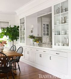 """Colonial farmhouse touches ... I love the """"window"""" into the kitchen. Much cozier than completely opening things up."""