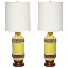 Pair Of Asian Inspired Yellow Glazed Ceramic Lamps, C. 1950 | From a unique collection of antique and modern table lamps at http://www.1stdibs.com/furniture/lighting/table-lamps/