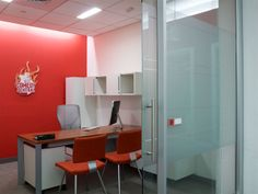 STUDIOS Architecture : MTV Networks - 345 Hudson; Playful office...precious chairs, floating mod shelves above, glass doors with mod handles.