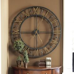 Though grand in scale, the airy openwork frame of our Chateau Betton Clock won't overwhelm your room. It also let's your wall color become part of the design.