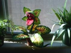 previous pinner says: Here is my new little plant he is made of paper mache and dollar store leaves.