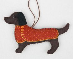 Note: For M, make D a bird Handmade felt Dachshund dog ornament for Christmas or any occasion. Bruno is a Dachshund made from dark brown felt, with a jolly buttoned jacket in orange dotty cotton fabric and a cotton loop for han Quilted Christmas Ornaments, Dog Ornaments, Felt Owls, Felt Animals, Dog Crafts, Felt Crafts, Dog Template, Felt Fabric, Cotton Fabric