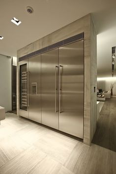 Wall of stainless refrigerators...