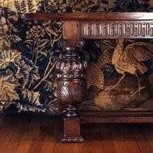 Elizabethan style carved oak dining table