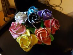 Full-bloom roses by Toshikazu Kawasaki in multiple colours with gold/silver trim