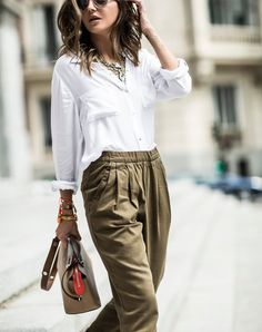 This outfit is all about comfort. A fluid top and comfy trousers could read a little pajama-y, but tucking in the blouse and adding statement accessories upgrades the look without sacrificing coziness.