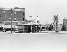 A Gilmore Gasoline station at the northeast corner of Wilshire and La Brea (1928), via the USC Libraries-Dick Whittington Photography Collection