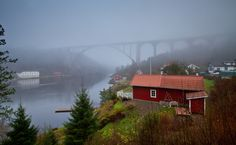The Norway-Sweden border and the old Svinesund bridge, on a foggy November day, 18th November 2015.  Norway on the left (north) side of the fjord, Sweden on the right. Before this bridge opened (15th June 1948) this fjord (with pedestrian/car ferry) was the main connection between central Norway and western Sweden. Also the Scandinavian passport union did not come into effect before 1st July 1954, so i guess there must have been a lot of paperwork in those days. The large white building is…