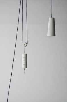 Graffe VOSGESPARIS FUORI MERCATO ZOOILAB.  30/70 is a pendant lamp from a solid concrete block by Italian Graffe  #lighting