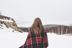 Travel girl with plaid in the winter day. - Travel girl with plaid in the winter day outdoors.