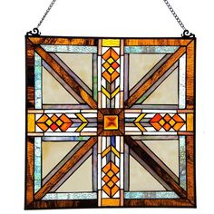 The Stained Glass Southwestern Mission Style Window Panel features a diamond and arrow pattern that runs through the center of each side. The warm colors complement the vibrancy of the red diamonds an