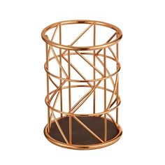 Trace+Copper+Pencil+Cup+-+Keep+your+pens+close+at+hand+with+the+Trace+Copper+Pencil+Cup+from+Design+Ideas! This+sleek+metal+wire+pen+pot+might+be+a+handy+storage+solution,+but+it+also+a+stylish+desk+feature+to+boot!+Boasting+a+geometric+wire+pattern,+this+cool+copper+desk+tidy+will+ensure+your+home+office+is+bang+on+trend.+If+you're+always+finding+yourself+uprooting+your+desk+drawer+contents+for+a+pen,+then+the+Trace+will+be+your+new+favourite+desk+companion! This+designer+pen+pot+wou...