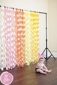 paper chain backdrop combine this one with the plastic table clothes to break it up...