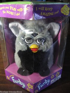 Furby.  I got this one for Christmas when I was a kid.  I also got a Furby Baby for my next birthday.