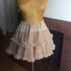 """AMERICAN APPAREL reversible tutu in peach!  Oh man is this the cutest thing I own!  It is 14"""" long and has two looks. Depending how you turn it. It has definitely gotten use but because of the fabric can go another few miles for you!  It is also a petticoat. American Apparel Skirts Mini"""