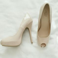 Cathy Jean Peep Toe Pumps Selling for a friend  Worn once 4 1/2 inch heels Lighting makes  it look like a  pink tone nude but it's more of a brown tone nude color. Cathy Jean Shoes Heels