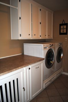 Laundry room... consider building in a dog kennel, laundry sorter, and platform for front loaders.