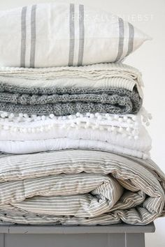Gorgeous simple greys and whites - the perfect type of Bed linens