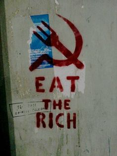 """Eat the rich"" on a wall at Naples Italy"