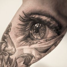 Realistic Eyeball Tattoos | This awesome photo realistic eye tattoo is by Niki Norberg
