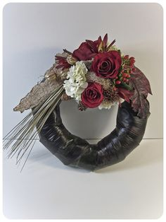 Unique black wreath base --- black is always striking (I'd use spray paint instead of plastic wrap).lee gallison aifd - Krop Creative Database