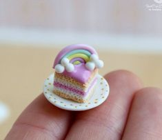 Miniature rainbow cake on a saucer. Miniature dessert. 1:12 scale. Handmade, polymer clay. Dollhouse food. Miniature food. The cake and saucer is made by hand from polymer clay. Cake are not glued to the saucer. Not intended for small children. Becomes a beautiful decoration doll