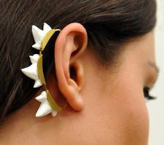 Aleksandra Puchacz gold-tone ear cuff is set with hand-carved porcelain shark teeth. This stunning ear