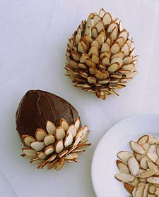 These are pointed ovals cut out of a single layer of cake, frosted, with sliced almonds arranged in the frosting to look like pinecones!