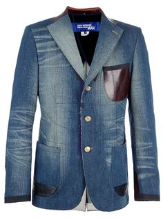 Blue cotton denim blazer from Junya Watanabe Comme des Garçons featuring a gold-tone front button fastening, long sleeves with button fastening cuffs, contrasting black leather panel detailing to the rear, a brown leather patch pocket at the chest and a rear vent.