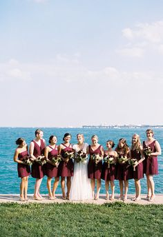 Seaside bridesmaids in short burgundy dresses // Ashley Bosnick Photography