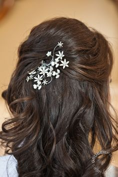 Add a floral pin to you half-up/half-down hair style for added elegance and manageability