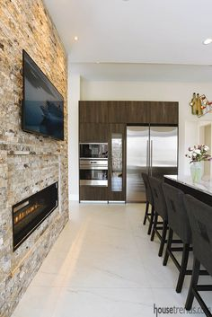 A great look at one side of the amazing kitchen in this house by Novum Custom Homes. #housetrends https://www.housetrends.com/specialist/Novum-Custom-Homes