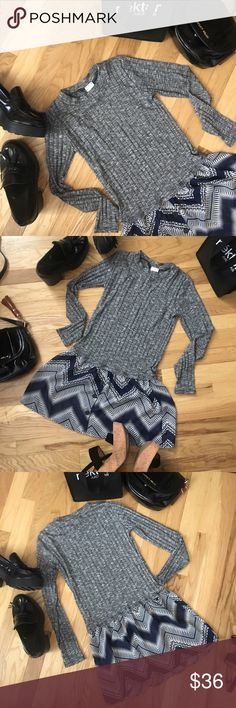 "Whatever 😍 You'll be snazzy and happy in this gray and navy blue comfy top! Pairs excellent with jeans pants or skirt! Easy piece to dress up or dress down! A contrast playful zig zag hem, with a very light weight gray bodice. It's so cute! 65% polyester 30% rayon 5% spandex for the perfect charming fit! Company size chart small fits 4-6. Underarm across not stretching (does have stretch) 15 1/2"", length approx 30"". Tops"