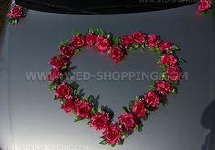Foto Les roses rose fonce pour decoration voiture mariage