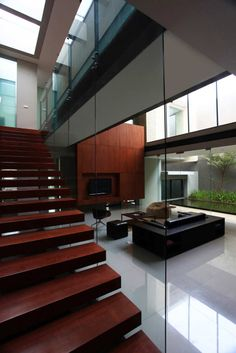 Reflected Staircase The Tan Residence. Interior Design and Architecture By Chrystalline Artchitect