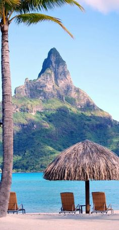 Mount Otemanu, Bora Bora, French Polynesia.. love the thatched roof bungalow