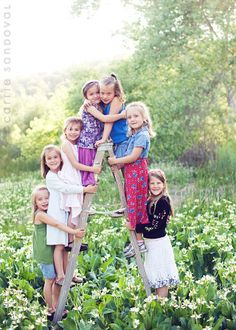 This is a neat idea for photographing several kids at once, when all of the cousins or grandchildren are together! (Parents &/or grandparents could also stand in the front.)