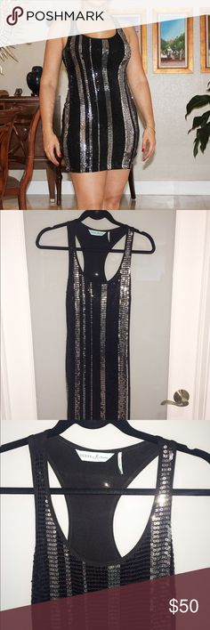 Guess by Marciano halter back sequin striped dress Guess by Marciano halter back sequin striped dress. Stunning mini dress. Black and silver. Only used once. Great condition. Size XS. Guess by Marciano Dresses Mini