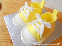This sweet fondant baby converses may look complex   but can be made easily with a basic sugarcraft skills   and a few useful tools.   T...