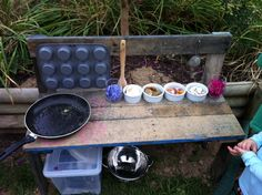 Mud kitchen version one, made out of pallet wood. Would like to add an oven at the bottom left, and cut a hole in the bench top on the right to hold a bowl as a sink.