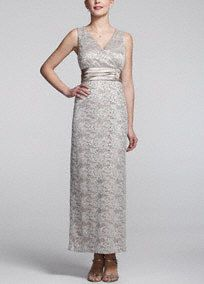 Long, elegant, and oh so classy! You will love the way you look in this lace dress! Sleeveless ensemble features all over feminine and delicate lace detail. Charmuese empire waist helps create a stunning silhouette. Side brooch detail adds glamour and finishes off the look. Fully lined. Back zip. Imported polyester/spandex blend. Hand wash.A bodice with a high waistline directly below the bust. A great look for most body types.