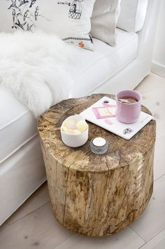 Sanded log as side table