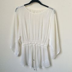 Blouse Sheer blouse with glare sleeves. Has a tiny yellow stain but hardly noticible. 100% polyester bebe Tops Blouses