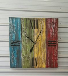 Weathered barnwood wall clock with distressed paint