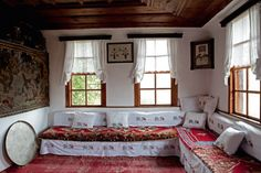 Ottoman farmhouse interior with built in seating and a copper tray for serving meals.