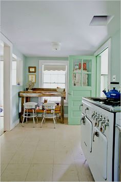 House of Turquoise: Catskills Cottage - love the mint door